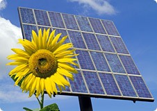 Solar power with a sunflower in forefront