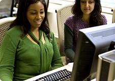 Women training on computers