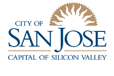 """San Jose City logo depicts the words """"City of San Jose Capitol of Silicon Valley"""" in Times New Roman font with the shape of a sun rising behind the letters."""